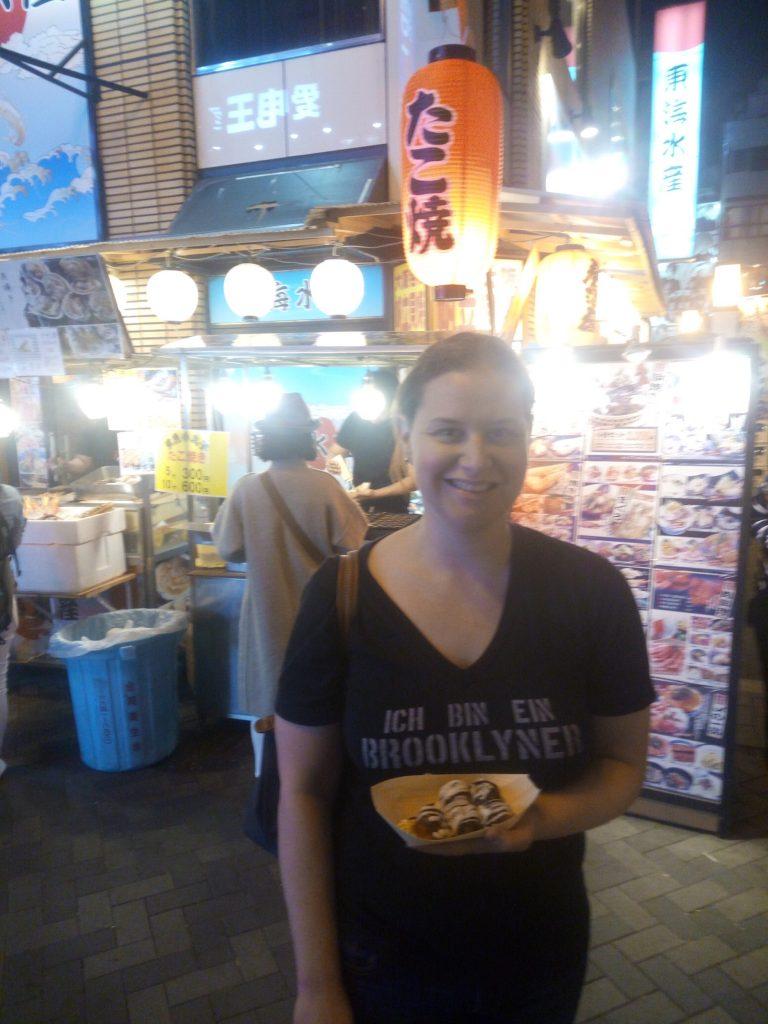 Eating Takoyaki on Dotonburi Street, Osaka, Japan
