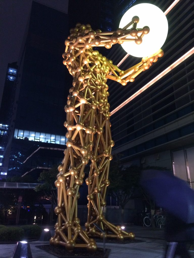 Gold man with orb, Seoul, South Korea