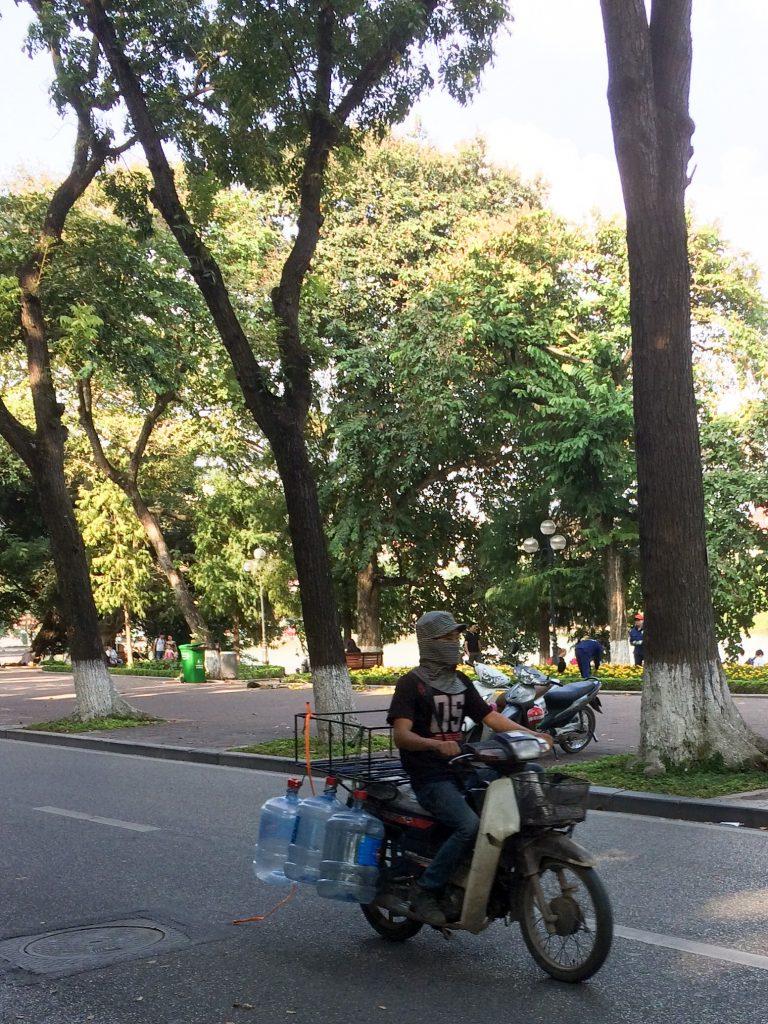 Motorbike with water jugs, Hanoi, Vietnam