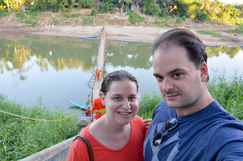 Happy after crossing the newly completed bamboo bridge in Luang Prabang, Laos
