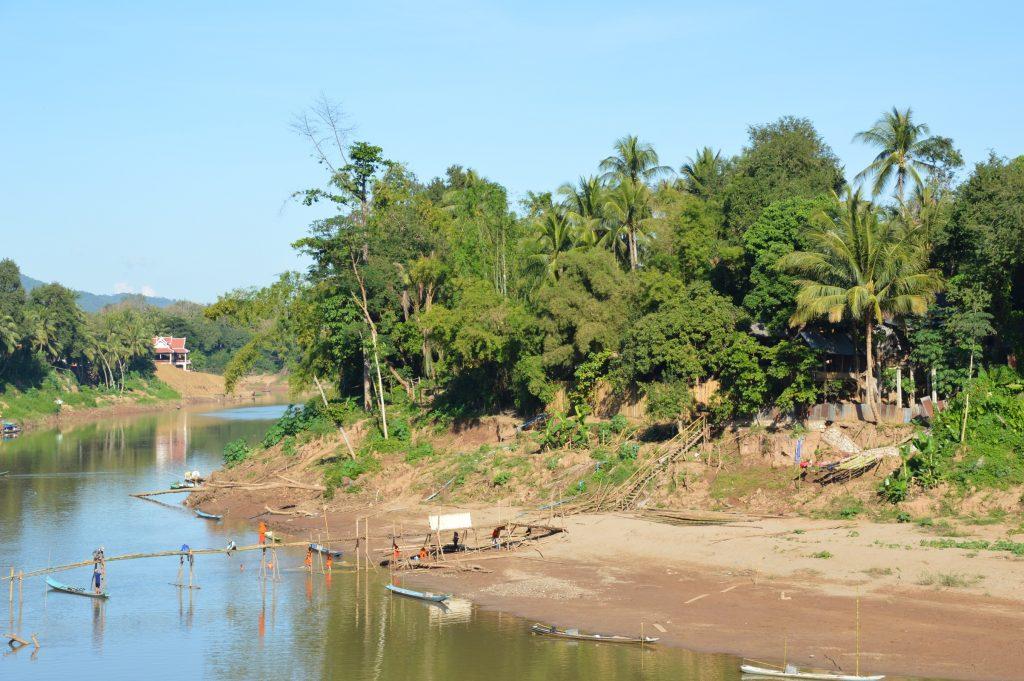 View of half-complete bamboo bridge over the Nam Khan in Luang Prabang, Laos