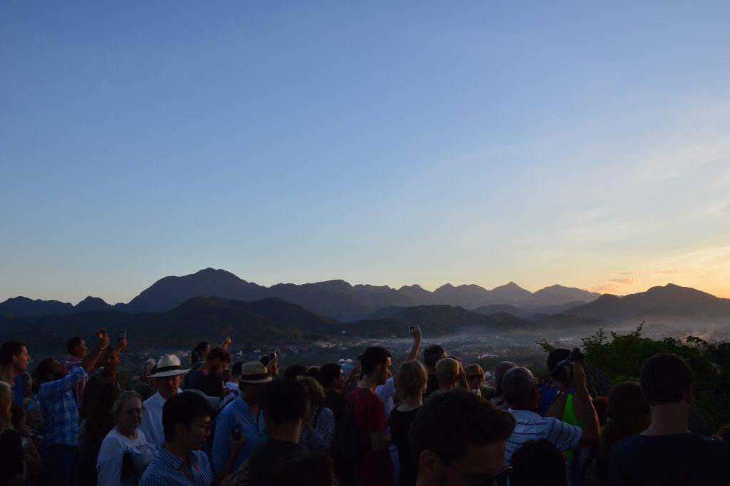 Sunset-watching crowd atop Mt. Phousi, Luang Prabang, Laos