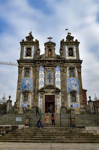 Close-up of the facade of Church of Saint Ildefonso covered in blue and white azulejo tiles in Porto
