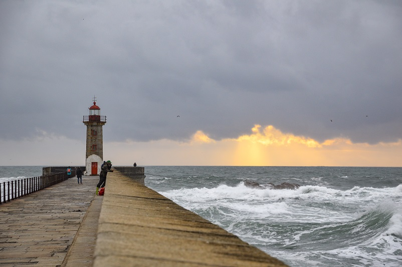 Pier with a lighthouse at the end in Foz do Douro in Porto, Portugal