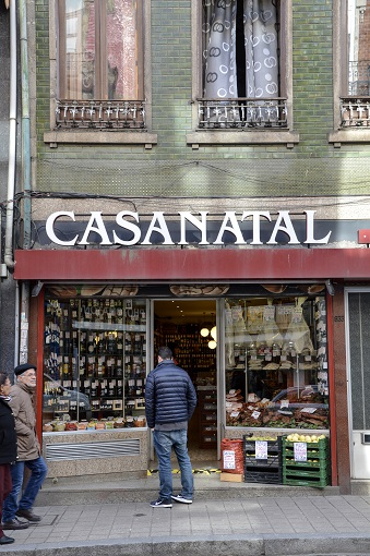 Justin in front of a storefront with the sign CASANATAL in Porto