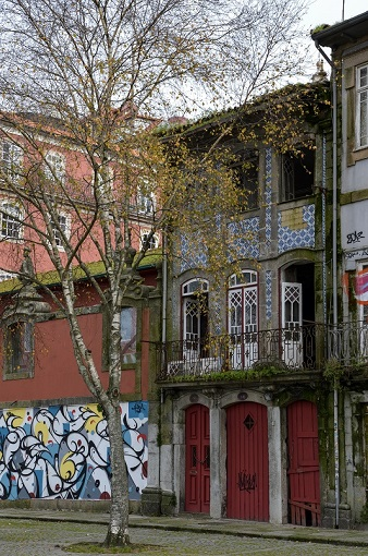 Colorful buildings and a mural in Porto