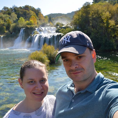 Sarah and Justin in front of a waterfall in Croatia
